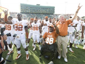 Texas coach Mack Brown, right, stands with Lt. Col. Greg Gadson following the Longhorns' win over Baylor earlier this season.  (University of Texas photo)