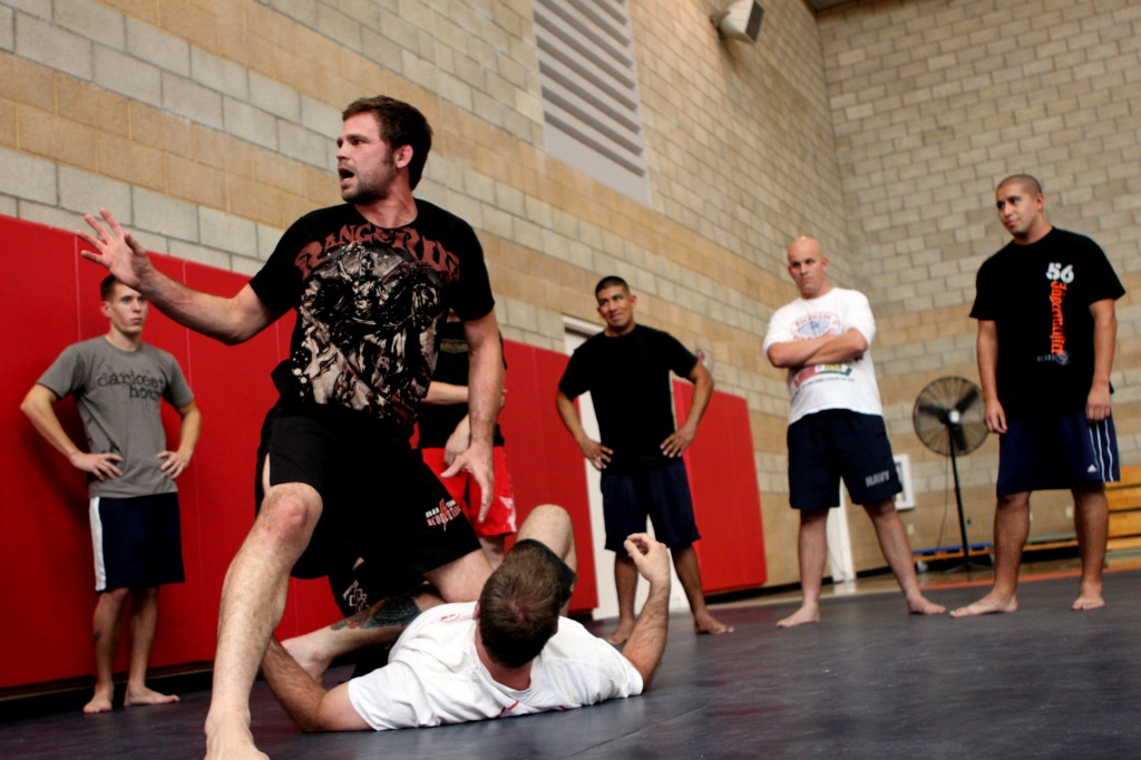 Tim Credeur, mixed martial arts instructor and fighter, explains the proper procedures for handling a down opponent during a special MMA clinic for Camp Pendleton Marines at Paige Fieldhouse, Oct. 26. Lance Cpl. Damien Gutierrez/USMC