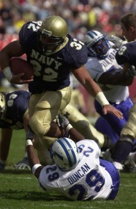 Kyle Eckel runs over an Air Force player during a 2003 game. ( Navy photo / JO1 Mark Faram)