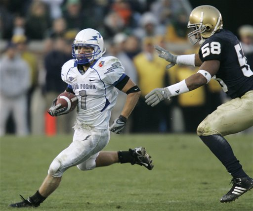 Air Force wide receiver Chad Hall, left, avoids the tackle of Notre Dame linebacker Brian Smith as he rushes in the third quarter of college football action in South Bend, Ind., Saturday, Nov. 10, 2007. Air Force defeated Notre Dame 41-24.  Hall rushed for 149 yard and had 31 receiving yards in the game. (AP Photo/Michael Conroy)