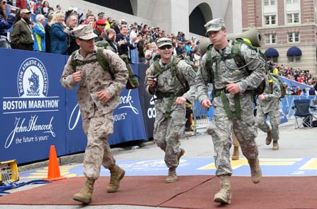 More than 20 miles later, the service members cross the finish line in Boston's Copley Square. (Bizuayehu Tesfaye // The Associated Press)